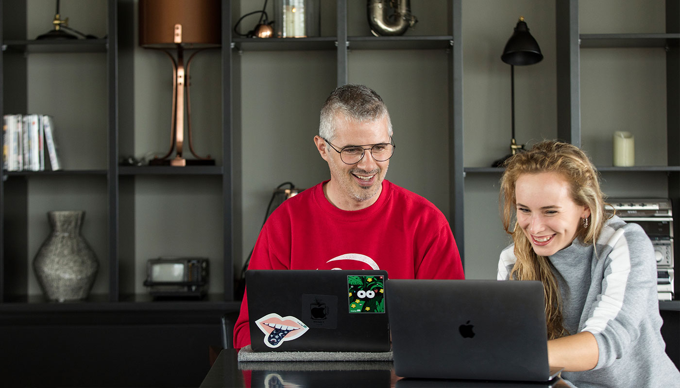 Two people working on a ycode website